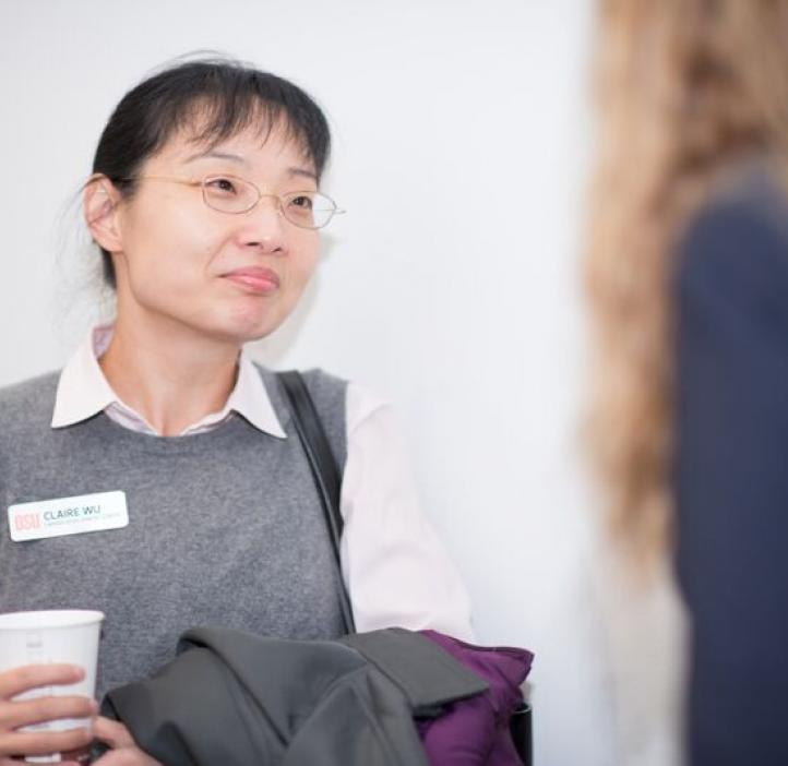 Claire Wu talking with colleague