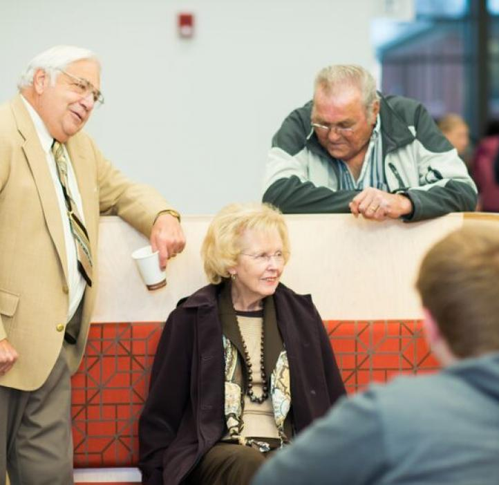 elderly colleagues talking at bench