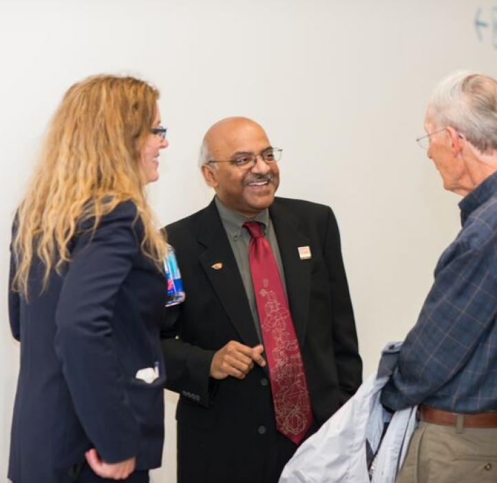 Karen Wooley and Sastry Pantula talking with colleague