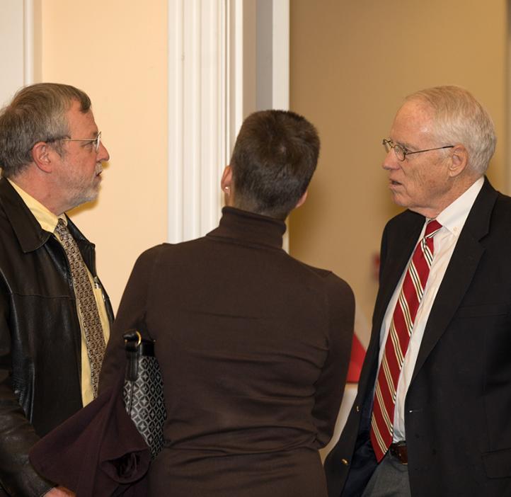 William Kirwan talking with faculty