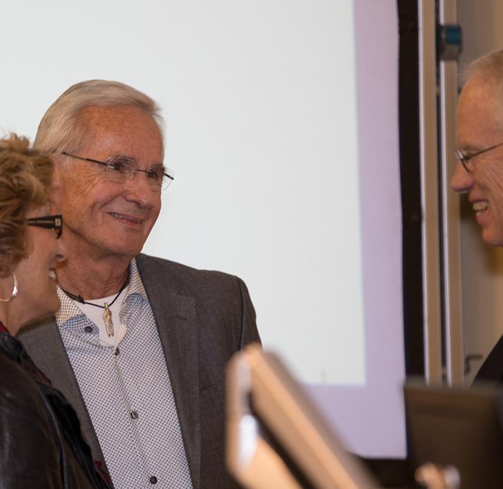 William Kirwan talking with colleagues