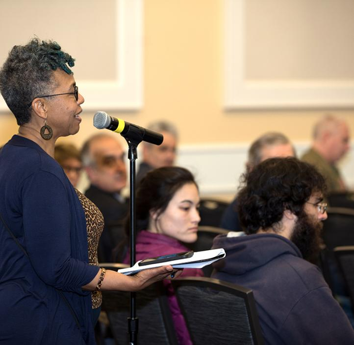 woman speaking from audience mic