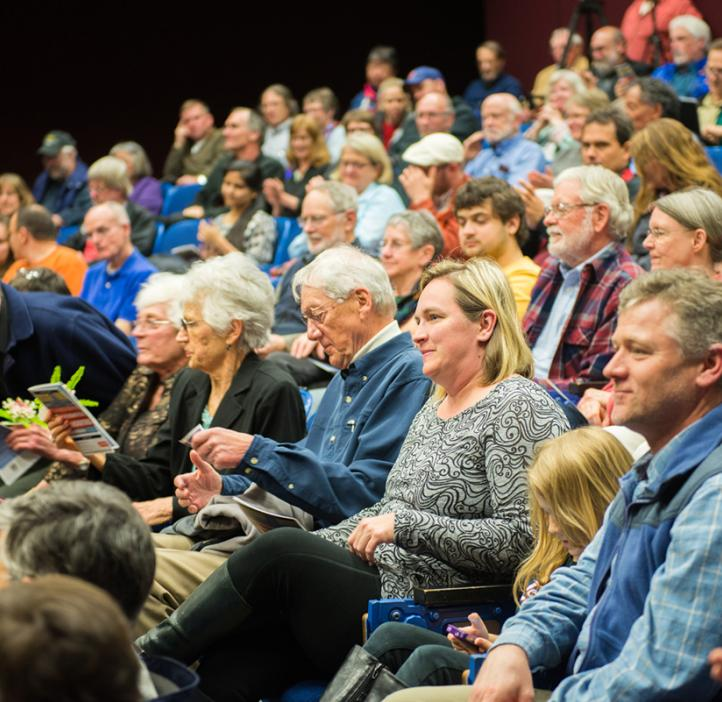 Gilfillan family sitting in audience watching lecture