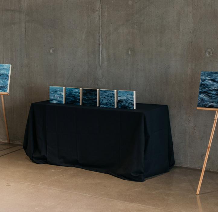 Abigail Losli ocean wave paintings on display