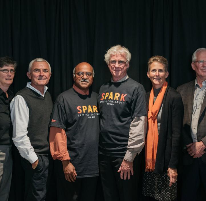 SPARK representatives in front of black backdrop