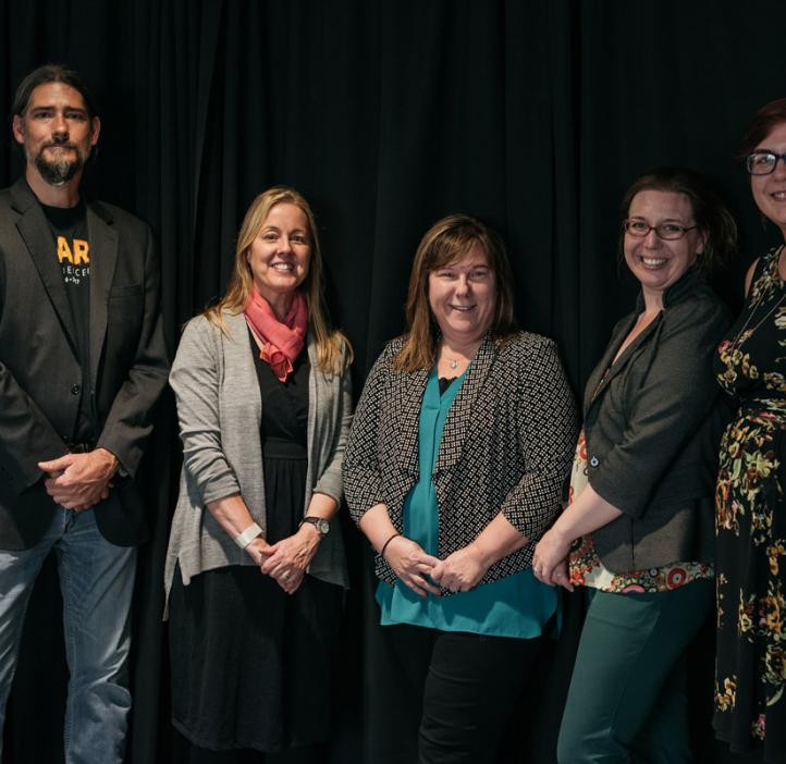 science staff in front of black backdrop