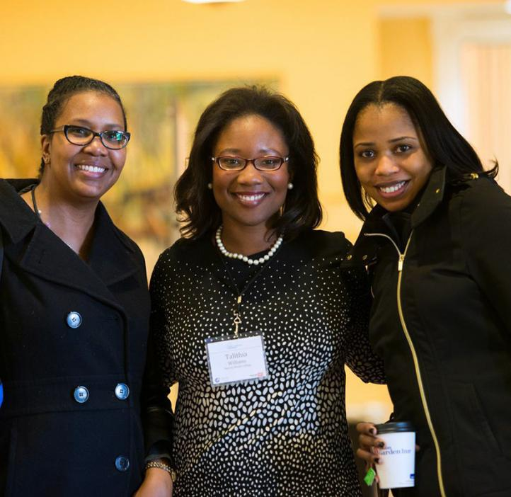 Talithia Williams with colleagues