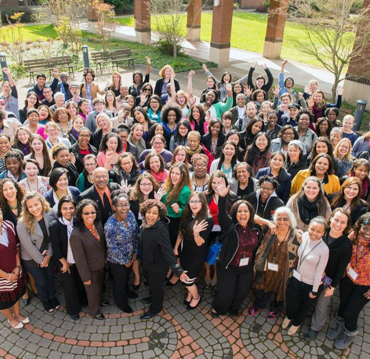 female conference attendees taking group photo outside