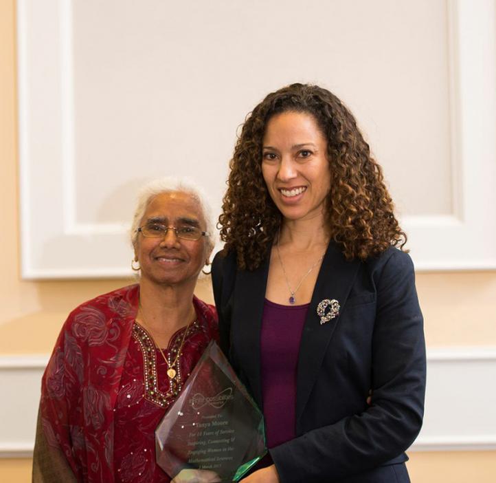 Tanya Moore holding award