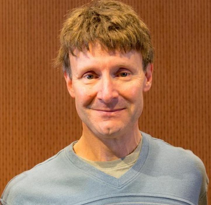Jeffrey Kollath, Statistics professor in front of wood backdrop