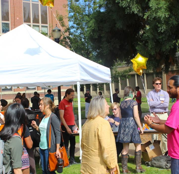 college of science community walking around booths