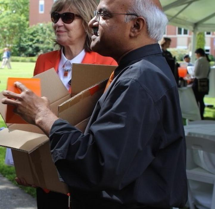 Sastry Pantula and Kathy Bickel talking with colleagues
