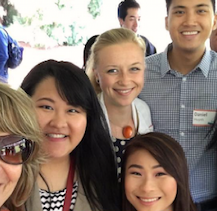 Kathy Bickel taking selfie with student