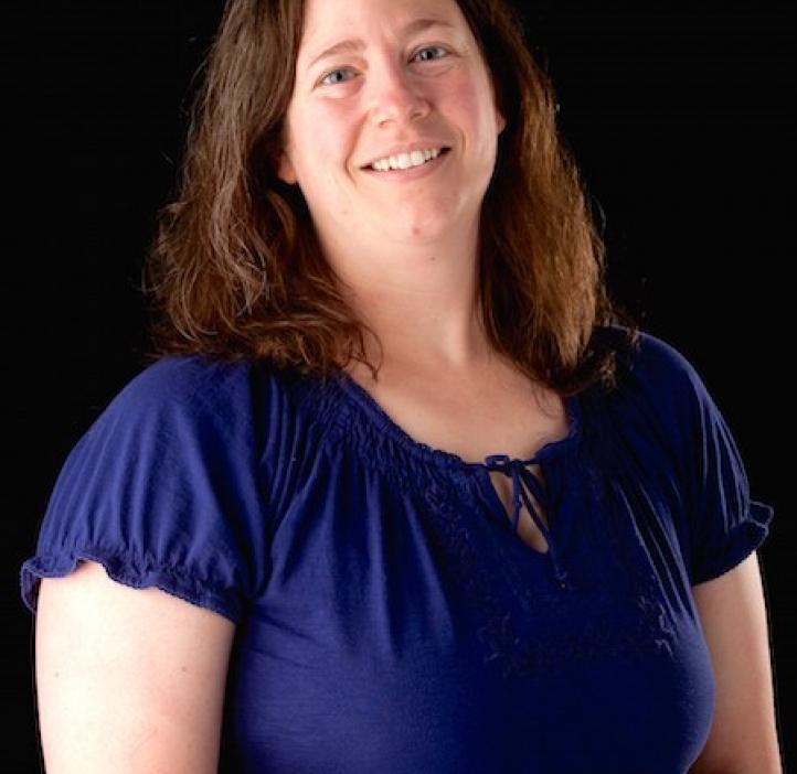 Marita Barth, Chemistry professor in front of black backdrop