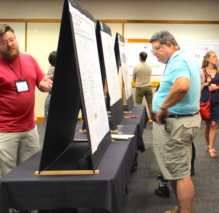 attendees looking at poster displays