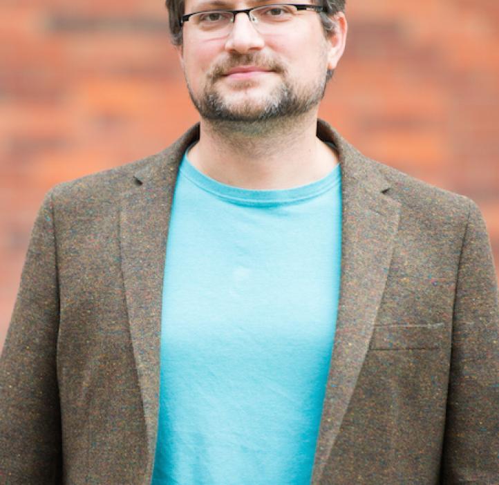 Radu Dascaliuc, Mathematics professor in front of brick backdrop