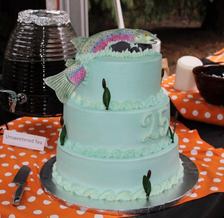 three tier cake decorated with salmon
