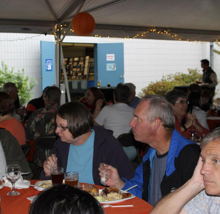 families and colleagues enjoying food at tables