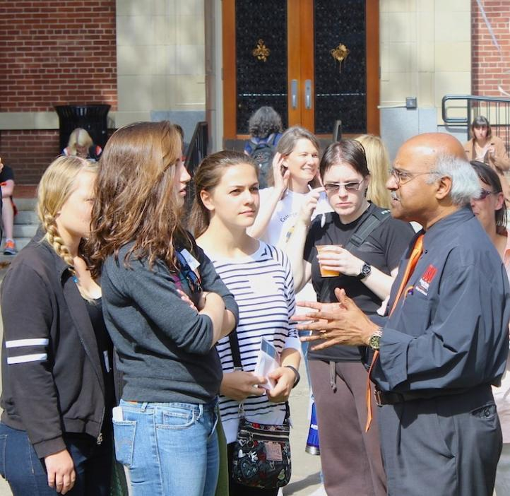 Sastry Pantula talking with female science students