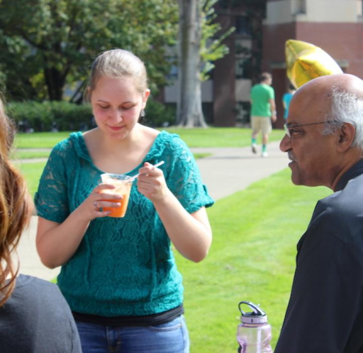 female science student enjoying ice cream float and talking with Sastry Pantula