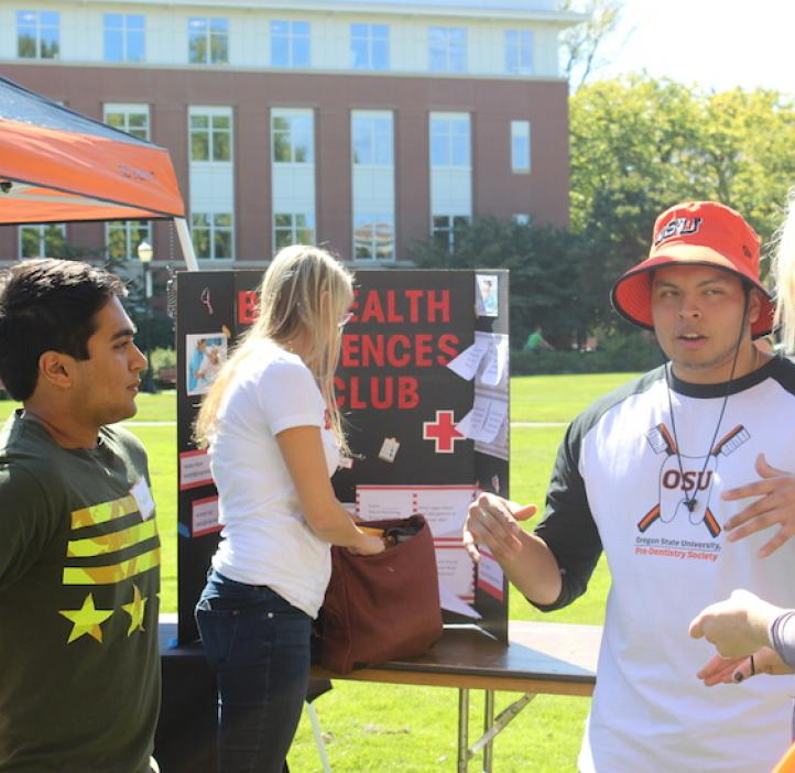 science students explaining their club booth