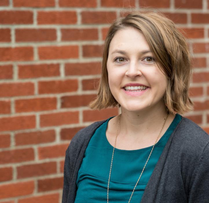 Sophie Pierszalowski, Biochemistry & Biophysics, in front of brick wall