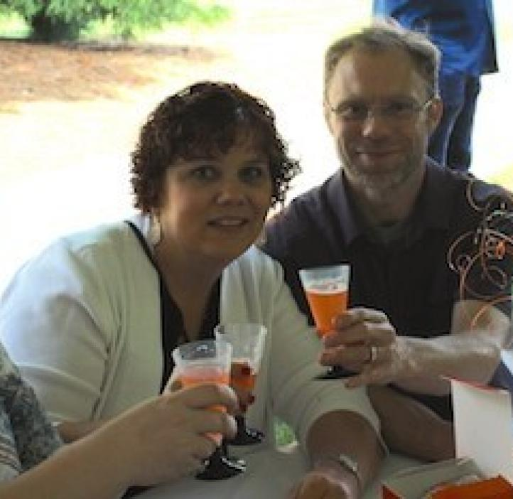 science faculty toasting drinks at table
