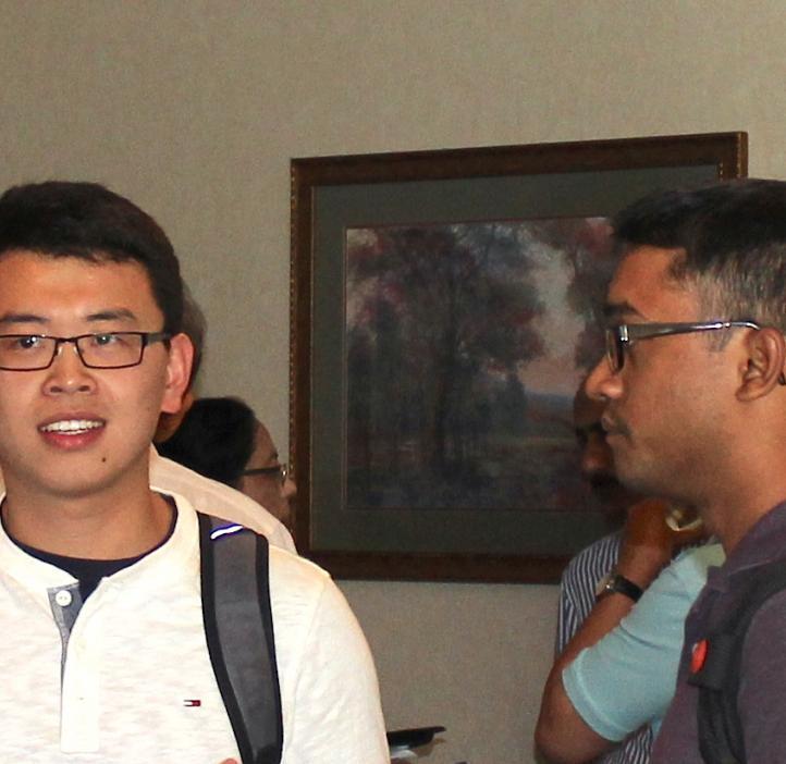 Male students talking in lobby
