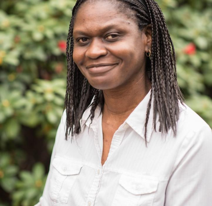 Afua Nyarko, Biochemistry & Biophysics, in front of shrubbery