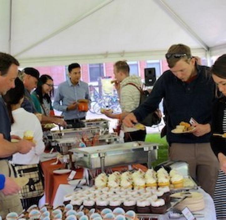 students grabbing food and cupcakes actable display