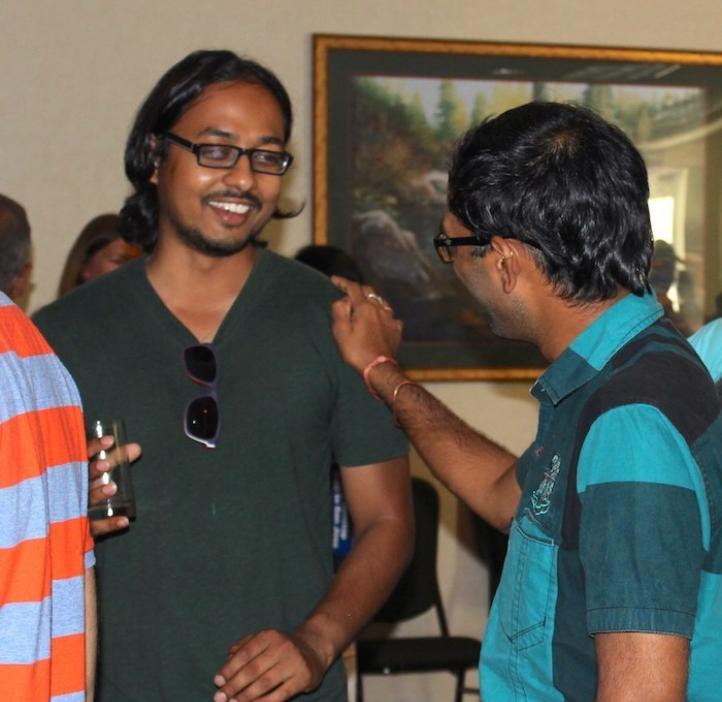 male friends talking in lobby