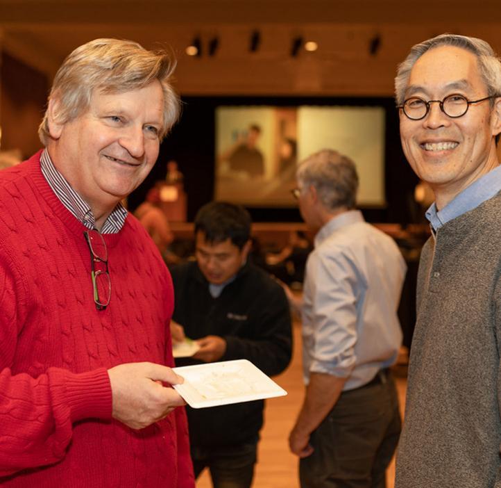 Joe Beckman and Victor Hsu talking over food