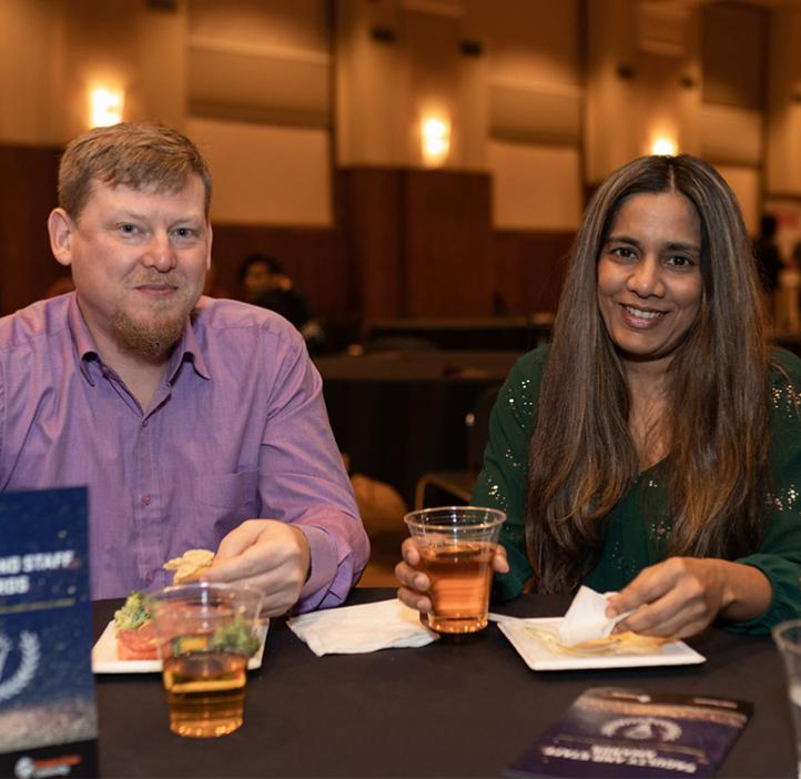 Vrushali Bokil with Nathan Gibson at table