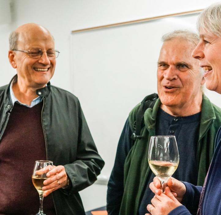 Science faculty talking over wine