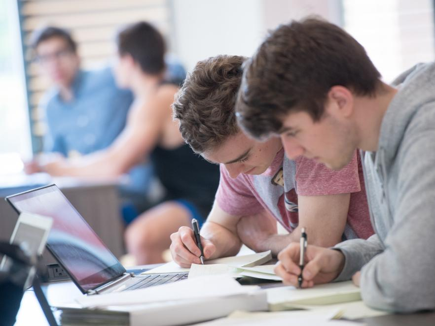 Two students studying together in classroom