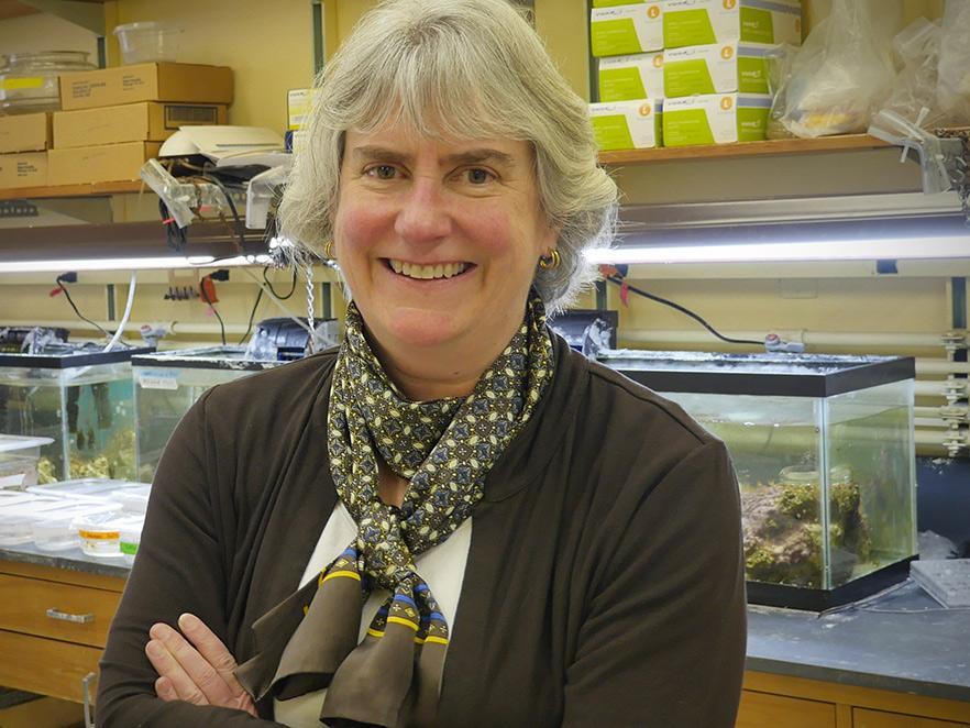 Virginia Weis standing in lab