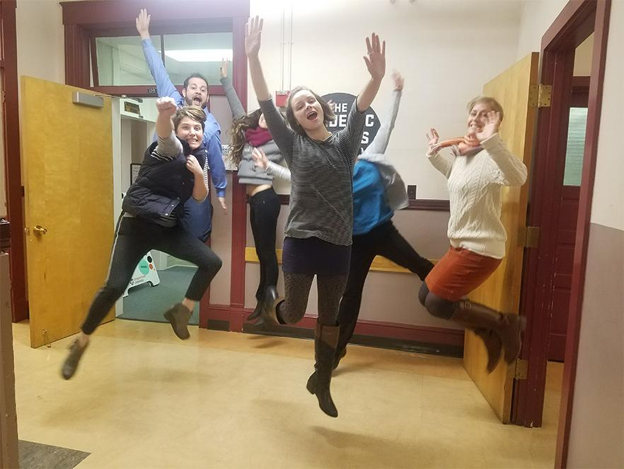 The Academic Success Center team jumping in hallway.
