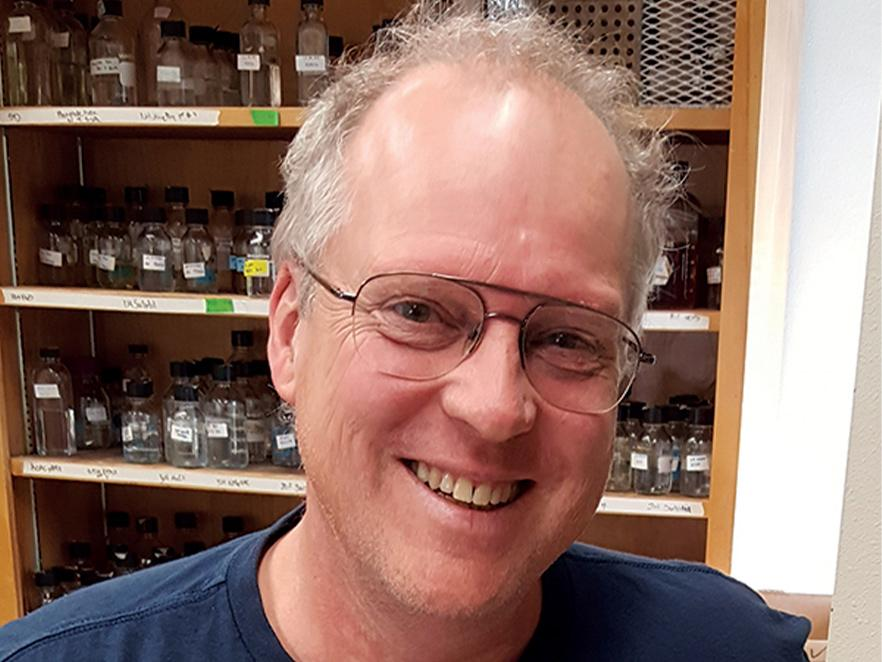 Michael Freitag standing in his lab.